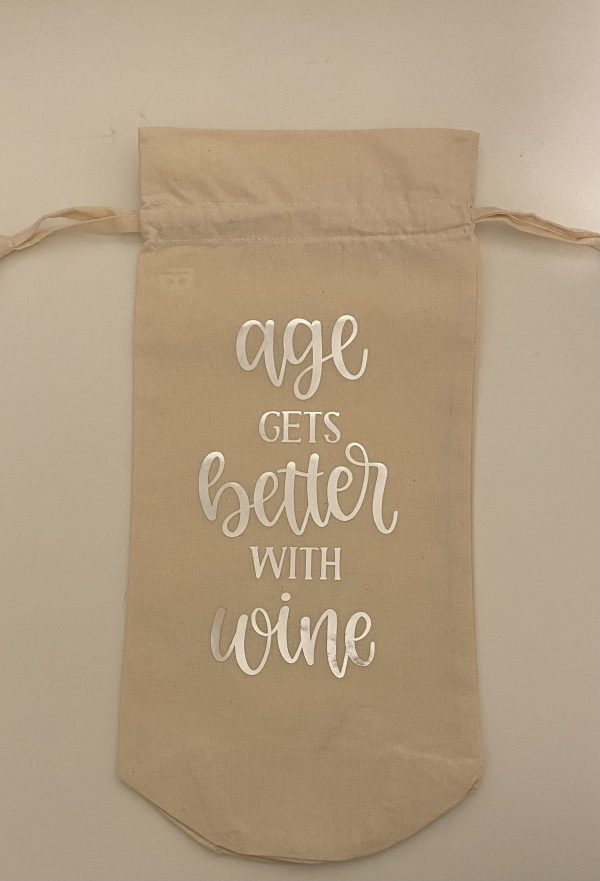 """Handmade wine bag with the words """"Age gets better with wine"""" in silver."""