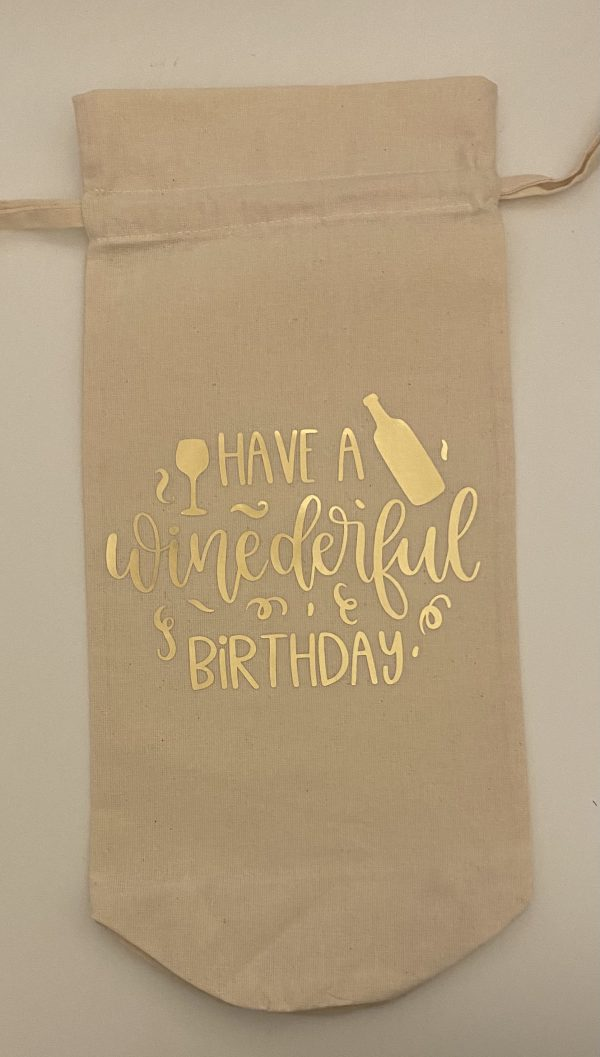 """Handmade wine bag with the words """"Have a winederful birthday"""" in gold. Around the words is a wine glass, bottle and some gold sparkles."""